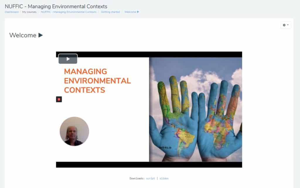 Image showing a screenshot of online learning platform Moodle with a photo two hands with world painted on it